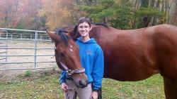 Student Annie Smith with her favorite Fairfield school horse, Sawyer!