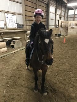Ella riding her pony, Rainbow!